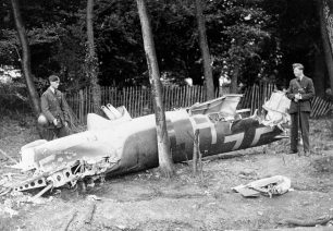 Image of RAF aircraftman guarding the remains of Dornier Do17Z-2 (F1+HT) shot down during the low-level attack on Kenley aerodrome, 18 August 1940. The aircraft crashed in Golf Road, Kenley at 1.20pm.