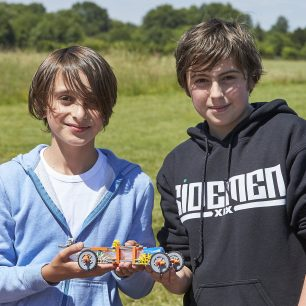 Two boys pose with their K'Nex car creation