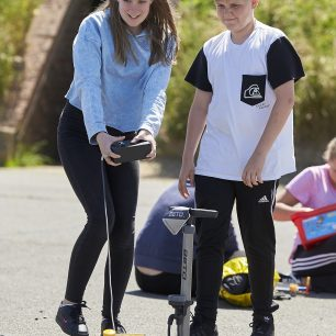 A boy and a girl launch their car during the K'Nex competition