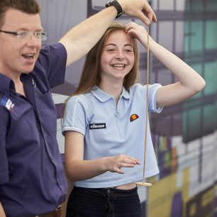 A girl volunteers to help with a demonstration in front of the class during the Bloodhound Workshop