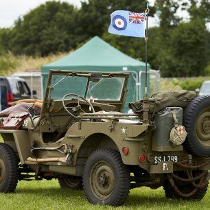 An old World War Two military jeep sits parked on Kenley