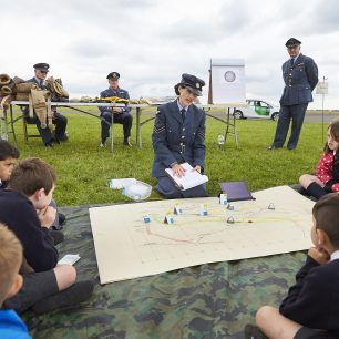 The WAAF re-enactors explains how communications and mapping works to a group of children