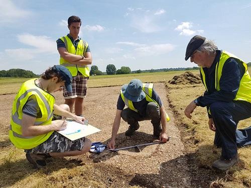 Volunteers recording concrete triangular