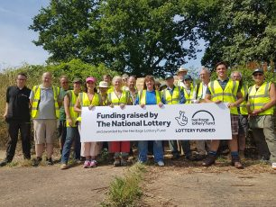 Volunteers celebrating Community Archaeology Dig