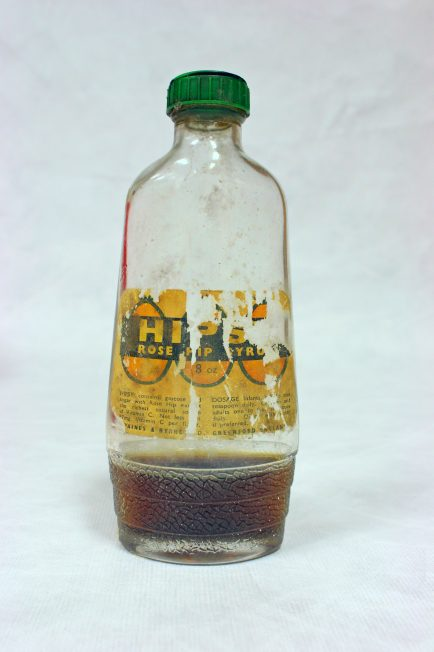 Glass 'Hipsy' Bottle with Rose Hip still inside