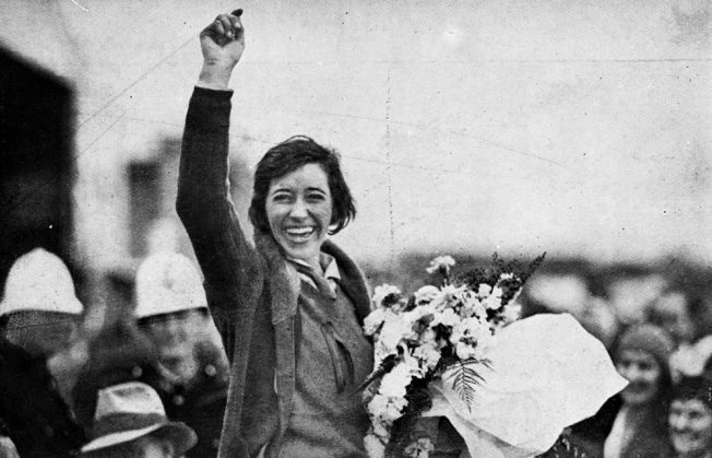 Amy Johnson waves to the crowd after landing at Brisbane, 1930 | The Queenslander