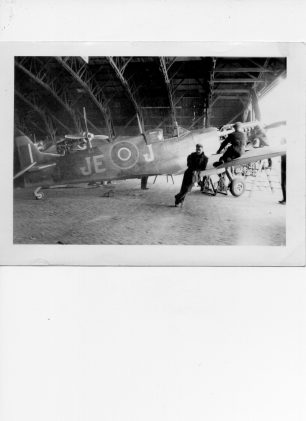 Image of Johnnie Johnson's Spitfire undergoing servicing in a hangar | George