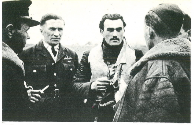 Sergeant Eugeniusz Nowakiewicz – a participant of The Battle of Britain, after shooting down another Me-109 above the English Channel. He shares his first impressions of the flight with the unit's commander Captain J. Kowalski. On the right we can see Lieutenant R.Narucki's ear, on the left there is Sergeant Domagała and adjutant of Squadron 302, Captain Łukaszewicz. RAF Kenley, 8.V.1941.