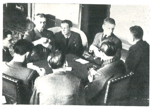 The game of rummy, officers' mess at RAF Kenley. From the left: Captain Julian Kowalski, Lieutenants Wacław Król and Stanisław Łapka, from behind Marceli Neyder, Jan Wydrowski, Zbigniew Wróblewski, an Englishman Paul Harding, Major Piotr Łaguna.