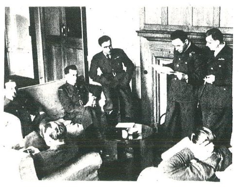 The day off. Pilots of Squadron 302 in the officers' mess at RAF Kenley, March 1941. From the right: Captains Julian Kowalski and Tadeusz Czerwiński - Units A and B Commanders, Adjutant Captain Łukaszewicz, Officers Wacław Król and Stanisław Chałupa, from behind Stanisław Łapka, sleeping Zbigniew Wróblewski.