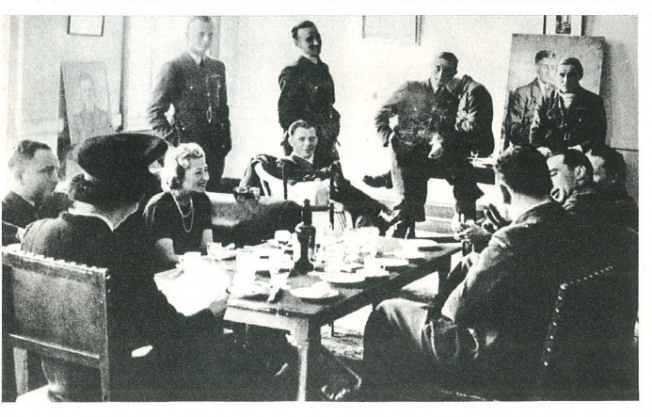 The visit of the artist, Mila Kamińska, at Squadron 302. Officer's mess at RAF Kenley, spring of 1941. From the left: Commander of Squadron 302, Major Piotr Łaguna, Mila Kamińska, Officer Marceli Neyder, Captain Julian Kowalski, Officers: Zygmunt Kinel, Czesław Główczyński, Zbigniew Wróblewski, Captain Tadeusz Czerwiński, Officer Wacław Król and Adjutant Captain Łukaszewicz.