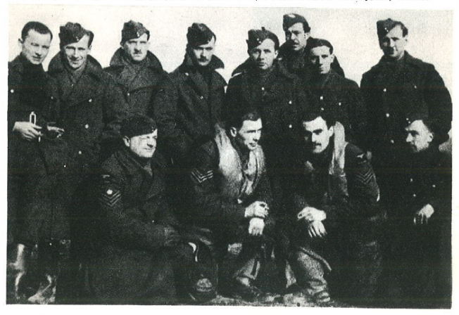 Pilots of Squadron 302, Sergeants A. Łysek and M. Nowakiewicz and maintenance staff of Hurricanes; mechanics, gunsmiths, radio technician. Kneeling on the left Senior Sergeant Bolesław Psujek, second on the right (standing) telephonist and signaller of the squadron, an Englishman. He gave the signal to start with the rocket. RAF Kenley, May 1941.