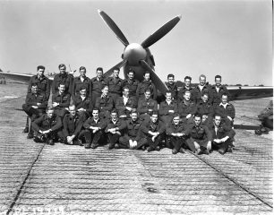Members of the 421 (Red Indian) fighter squadron in front of a Spitfire | Image used with kind permission of The Canadian Fighter Pilot and Air Gunner Museum