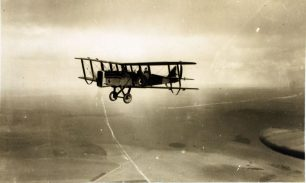 Image of an RAF DH.9A aircraft in flight taken from another aircraft