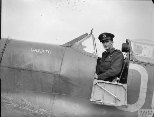 Wing Commander Wells shown sitting earlier in his career as a Flight-Lieutenant sitting in the cockpit of his No 485 (New Zealand) Squadron Spitfire VB at RAF Kenley | Copyright: © IWM. Original Source: https://www.iwm.org.uk/collections/item/object/205210160