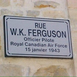 In 1994, the main street of St. Martin-Des-Entrees was re-named in Ferguson's honour.  | Crash in Bayeux by Francois Oxeant.