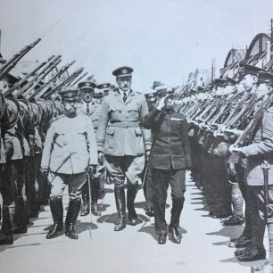 Crown Prince Hirohito inspecting personnel at Kenley, in May, 1921, accompanied by Air Vice-Marshal Sir John Salmond, followed by Flight Lieutenant J. M. Robb.