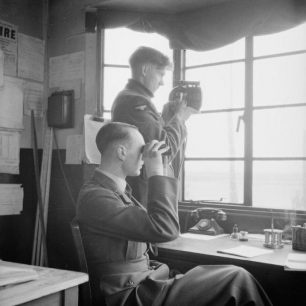 An Airman using an Aldis Lamp at RAF Catfoss, Yorkshire, in April 1941.  | F/O B. J. Daventry. RAF official photographer.