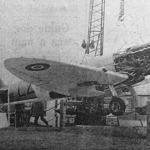 The Spitfire which has had a place of honour at Kenley Aerodrome for so long took off this week - but this time it's power came from a crane (above). | Coulsdon and Purley Advertiser