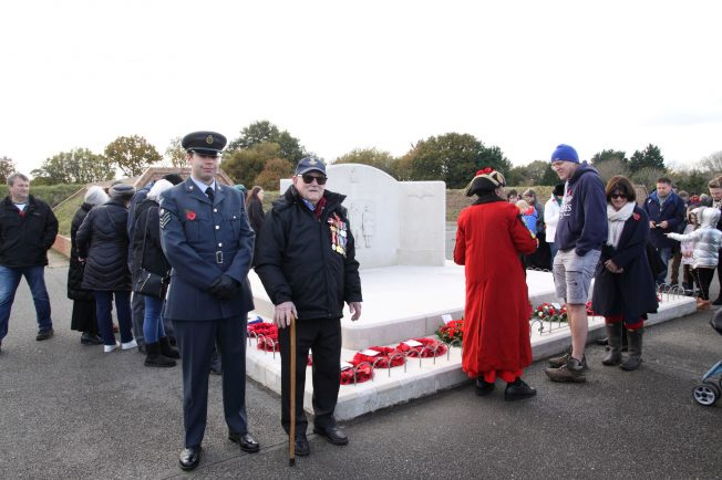 RAF Warrant Officer stands proudly next to a Kenley veteran while the public and Croydon Town Crier inspect the wraths laid a the Kenley Tribute | Tony Adams