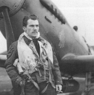 Flying Officer Ballantyne. The 403 squadron Wolf's head is clearly visible on the Spitfire behind him. | Canadian Virtual War Memorial