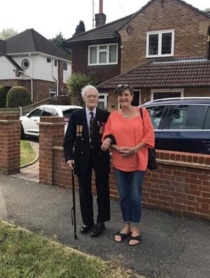 Local veteran Ken Raffield got a round of applause when he took a walk along Caterham Drive during the V.E. Day commemorations. | Portcullis Club