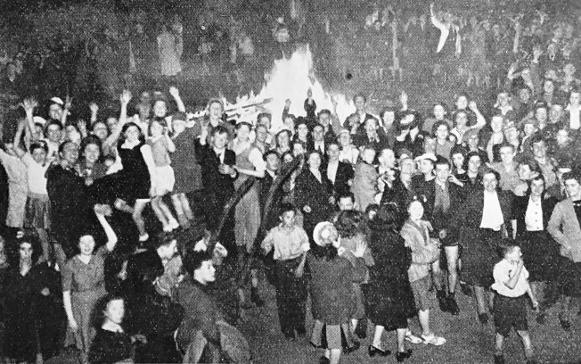Happy crowds dance round a bonfire in the East End of London on V.E. Day, 1945.  | Sport and General, The Second Great War, No.90