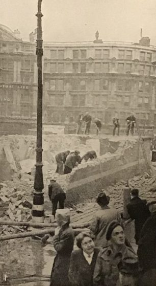 Workmen demolish the surface shelter outside St. Paul's Cathedral. | The Second Great War, No.90