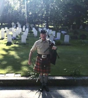Piper Bob Ash played to remember the fallen at Airmen's Corner, St. Luke's churchyard, Whyteleafe, on the 75th anniversary of V.E Day. | Andy Parr