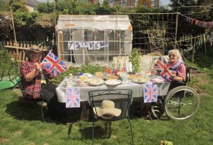 Kenley Revival supporter Doug Bolt and family celebrate the anniversary of V.E. Day in their garden. His Mum (right) was a wartime evacuee.  | Doug Bolt
