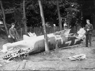 The wreckage of Dornier Do.17z-2 (F1+HT), after it was brought down by Kenley's Parachute and Cable system, crashing at 'Sunnycroft' on Golf Rd, with the loss of all on board.  | ©IWMHU70268