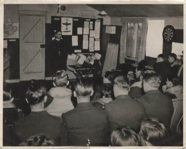 S/Ldr. Belton leads a church service for 403 Squadron at Kenley, 21/3/1943.  | Robert Brookes Collection