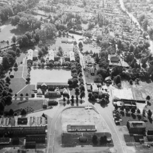 Aerial photo of RAF Kenley looking from the airfield towards the main gate, showing the gate guardian Spitfire.  | Alistair White