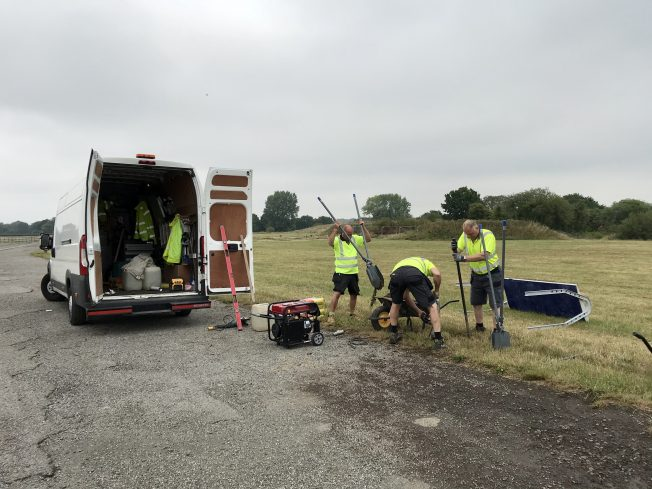 Contractors working on the installation of the new signs.  | Linda Duffield