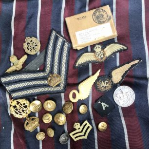 Flight Sergeant Glover's stripes, badges, buttons and keepsakes.  | Carol Brown