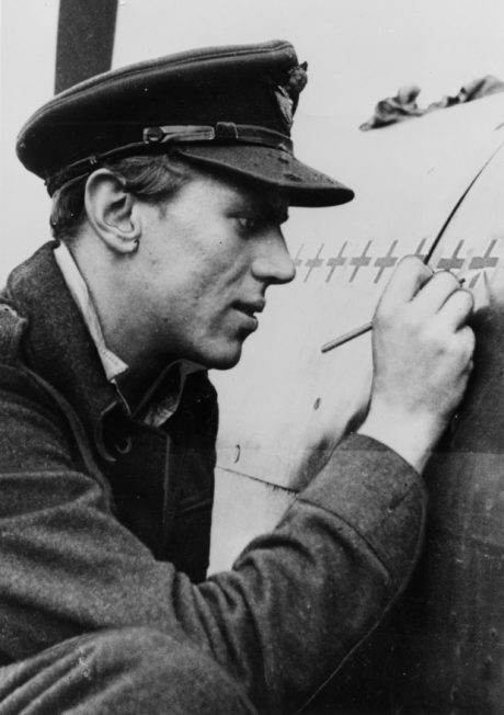 Beurling meticulously recording his tally of victories on his 403 Squadron Spitfire.