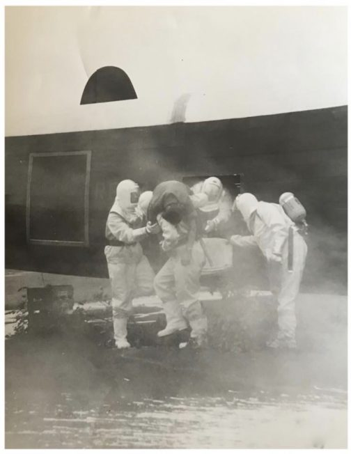A 'casualty' is rescued from the Avro Lincoln (RE242, ZQ-V) which was used for fire-fighting practice at Kenley.  | Jane Collman