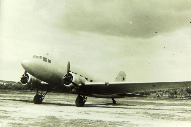 Image of a Russian Lisunov Li-2 transport aircraft in military markings | San Diego Air and Space Museum Photo Archives