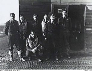 Pilots of No. 452 (Spitfire) Squadron, c. September, 1941, RAF Kenley. Left to right: Sergeant Clive Newton Wann; Flt Lt John Robertson Ross, Sgt William James Smith (sitting), Sgt Francis Gilbert Harper, Sgt Malcolm Wallace Hamilton Sgt William Jefferson Wilkinson, Sgt Raife James Cowan. | Australian War Memorial SUK10025