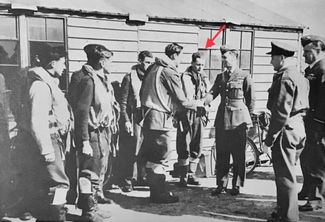 King George VI being introduced to pilots of the Kenley Wing after a sweep on 29th April, 1942. Sgt. Maskill is marked by the red arrow.  | RAF Kenley by Peter Flint