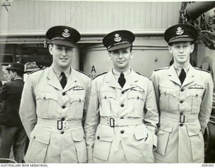 Departure of the ship 'Largs Bay' with the first party of RAAF members to complete their training within Australia under the Empire Air Training Scheme. Left to right: P/O William Wallace Anderson; P/O Sydney Douglas Marshall; P/O Geoffrey Lloyd Wells. All three were killed in action during the summer of 1941. | Australian War Memorial: 004342